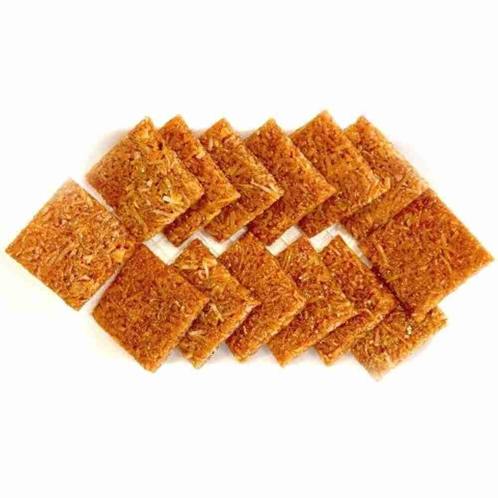 Picture of Coconut Chikki- 5 Rs Each (80Pcs)